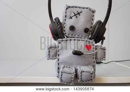 Soft Lonely Robot Toy With Headset at Call Center.