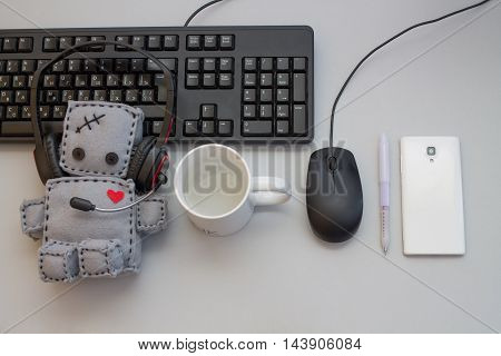 Soft Robot Toy work at Helpdesk. Flat Lay