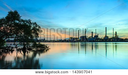 Oil refinery at twilightChao Phraya river Thailand