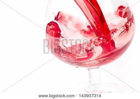 abstract patterns pours a drink into a glass of wine