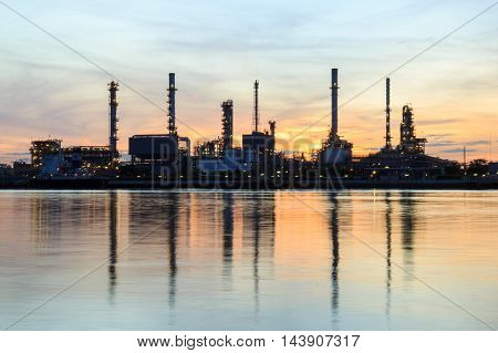 Oil refinery along the river at twilight time (Bangkok Thailand)