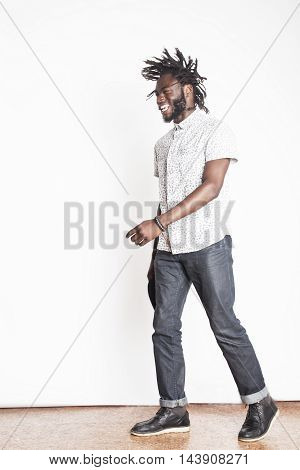 young handsome afro american boy stylish hipster gesturing emotional isolated on white background smiling, lifestyle people concept