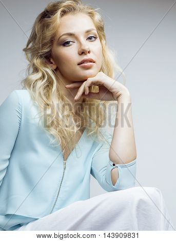 young pretty blond woman smiling on white background close up makeup, lifestyle people concept casual