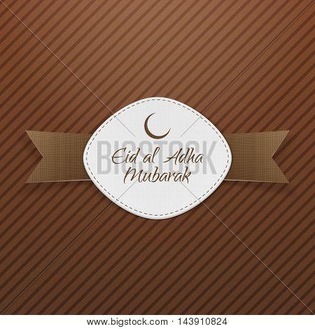 Eid al-Adha Mubarak Tag with Ribbon on brown Background