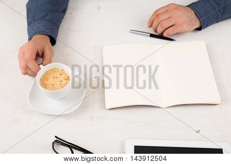 Open notebook with blank pages on the desktop in the office