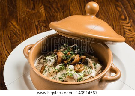 meat with vegetables in the pot
