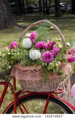 full basket of fresh flowers on the bike