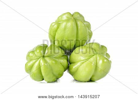 whole fresh chayote on a white background