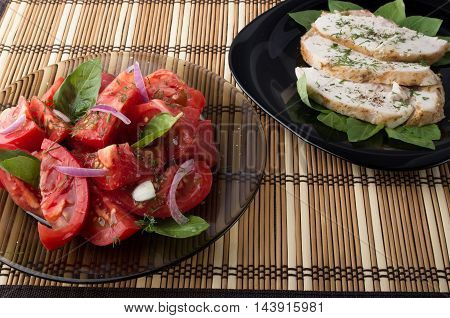 Tabletop With A Home-cooked Meal - Salad Of Tomato And Baked Chicken