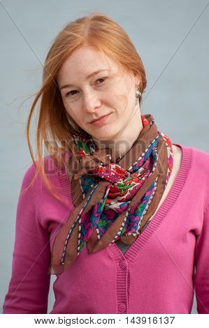 Portrait of beautiful redhead woman with scarf