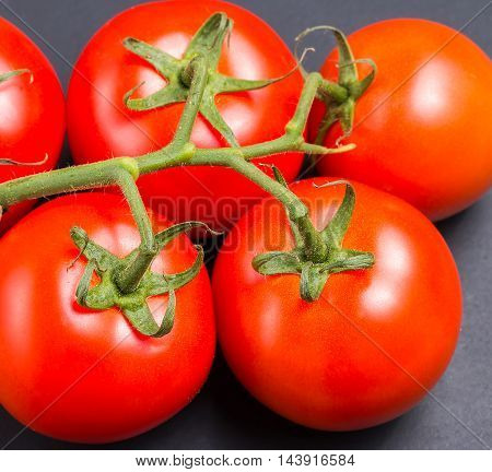 Freshly Picked Red Tomatoes From The Vine