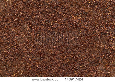 Organic dry neem (Azadirachta indica) powder. Macro close up background texture. Top view.