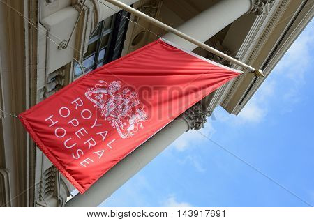 Covent Garden London England United Kingdom - August 16 2016: Red Flag of Royal Opera House set at angle