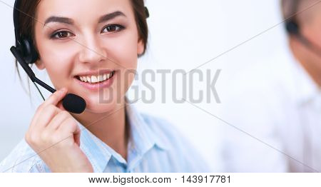Businesswoman with headset smiling at camera in call center atoffice