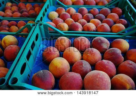 Fresh ripe peaches in boxes in whole sale market ready for retail