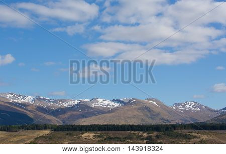 Snow topped mountains Ben Nevis Scotland UK in the Grampians Lochaber Highlands close to the town of Fort William in summer
