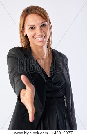 friendly business handshake woman with smile