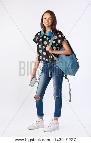 Happy mixed race hispanic asian woman student going back to school university