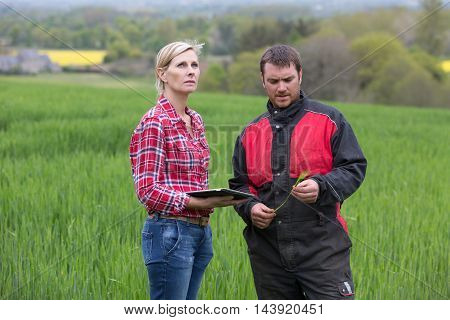 female farmer checking meteo with her notepad