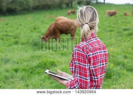 portrait of female Farmer using her notepad