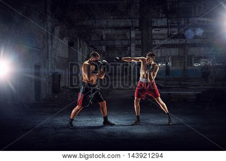 Battle of two boxers . Mixed media