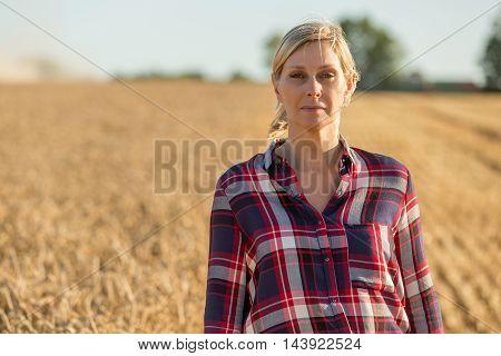 Portrait of beautiful female farmer with sun
