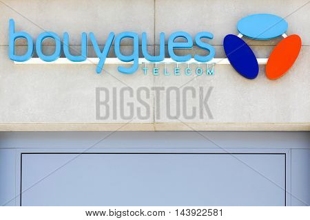 Lyon, France - August 15, 2016:  Bouygues Telecom logo on wall of a store. Bouygues Telecom is a French mobile phone and Internet service provider company, part of the Bouygues group