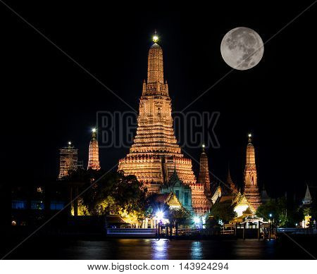 Atmosphere thai temple in dark time with full moon