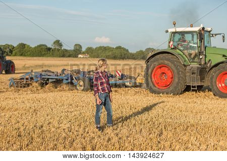 female farmer with her tractor in summer