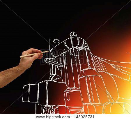 Man's Hand Draws A Design Of Factory