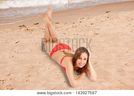 Smiling woman relaxing on the sand