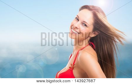 Woman on the beach in red bikini. Vacation concept