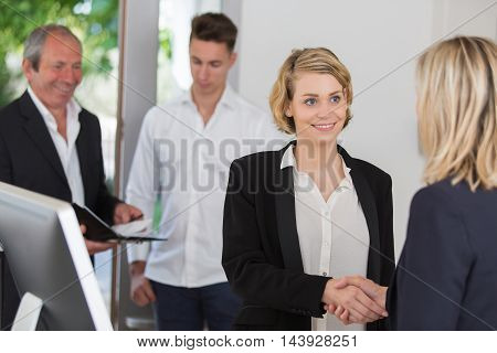 Business handshake and business people at office
