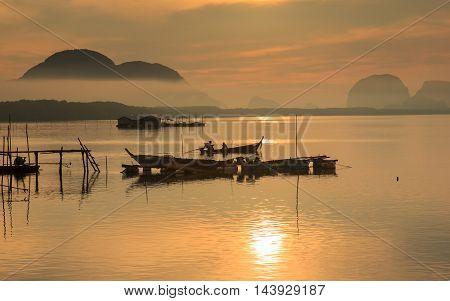 Good morning fishing village and sunrise at Sam Chong-tai Phang Nga Thailand edit warm tone