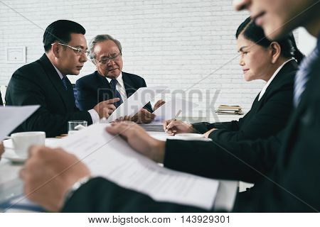 Asian team of lawyers working with papers