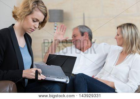 Senior couple meeting financial adviser for investment