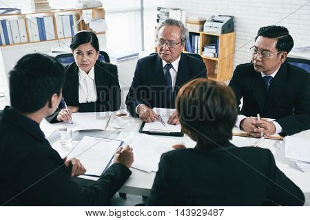 Group of lawyers negotiations during pretrial settlement