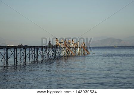 CORFU, GREECE - AUGUST 17, 2016: sea bathing people