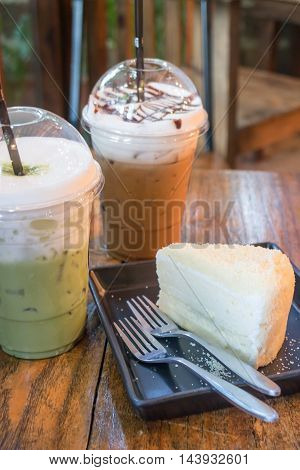 Cheese cake and iced caffeine drink stock photo
