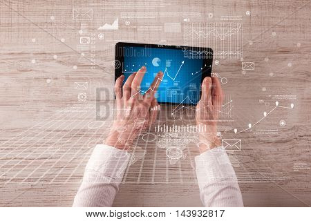 Caucasian business hands holding tablet with business screen