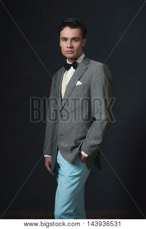 Vintage 1920S Fashion Man Wearing Striped Jacket And Blue Pants.