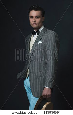 Man In Retro 1920S Fashion Holding Straw Hat.