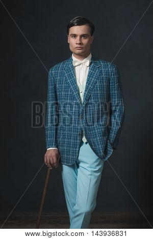Vintage 1920S Well Dressed Young Man Standing With Cane.