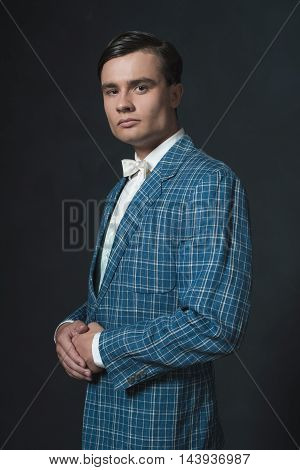 Young Man Wearing Retro 1920S Checkered Jacket With Bow Tie.