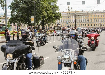 St. Petersburg, Russia - 13 August, Driving through a group of motorcyclists,13 August, 2016. The annual International Motor Festival Harley Davidson in St. Petersburg.