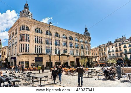 Narbonne France - April 8, 2016: People walking in a city main square in Narbonne Languedoc-Roussillon. France