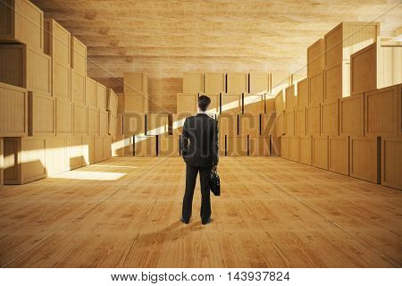 Businessman with briefcase standing in warehouse with wooden containers. 3D Rendering