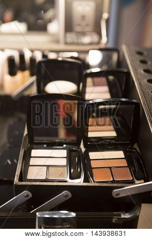 Professional Make-up suitcase with glamour eye-shadows beige colors