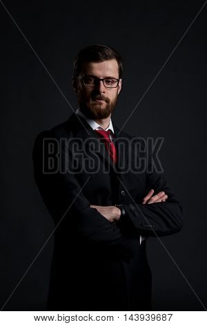 Portrait of businessman over black background. Face with beard. Business and office concept.