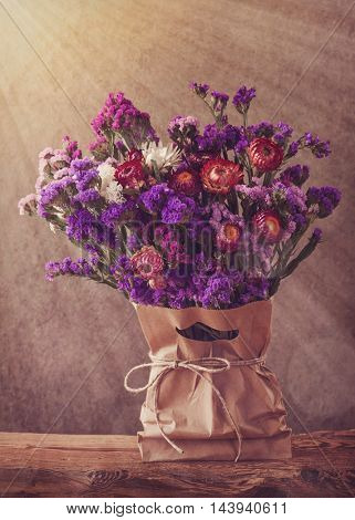 Lilac autumn flowers in a bag